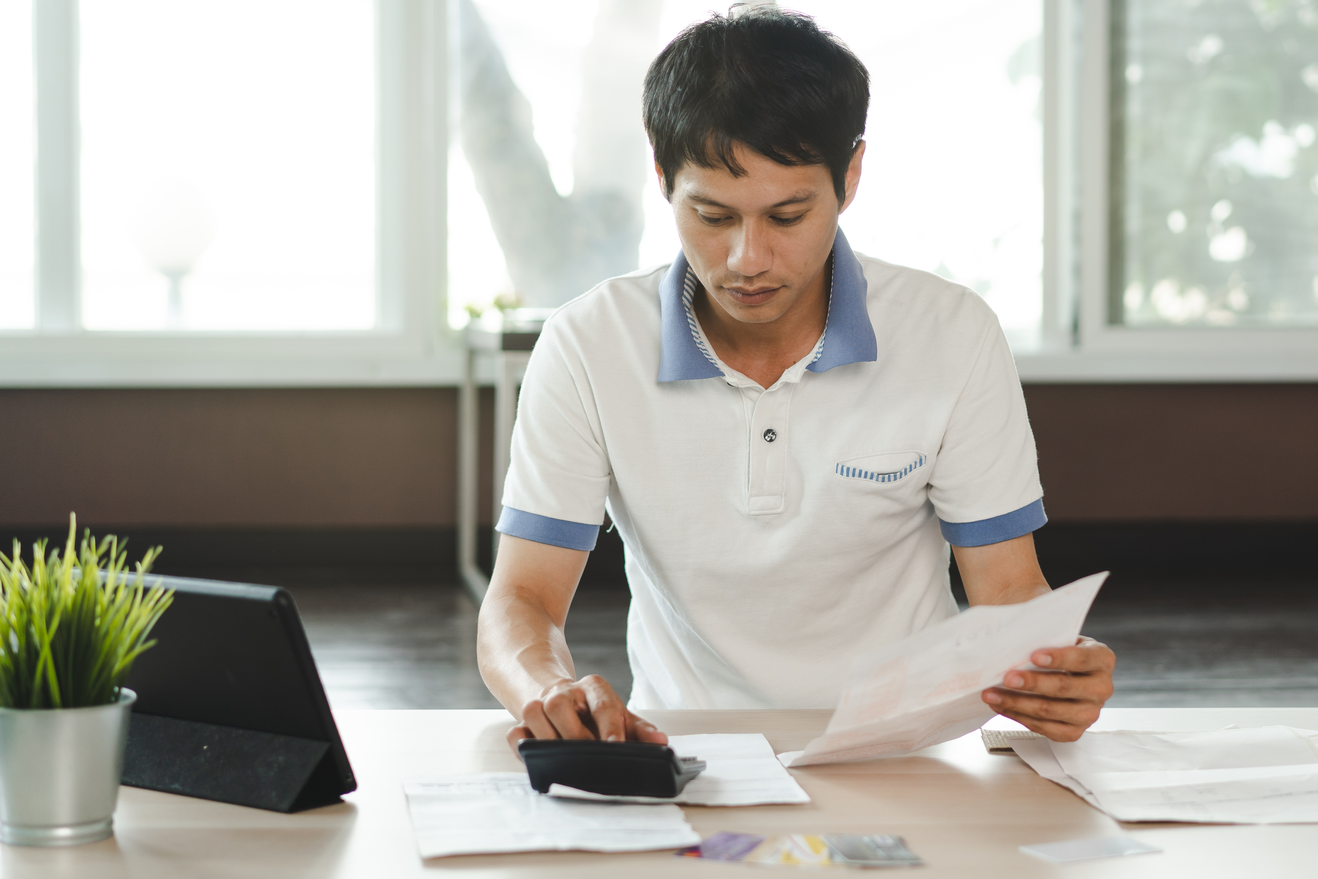 Stressed man calculating wealth management